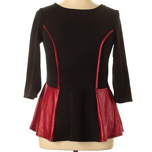 Black peplum top with faux leather detail